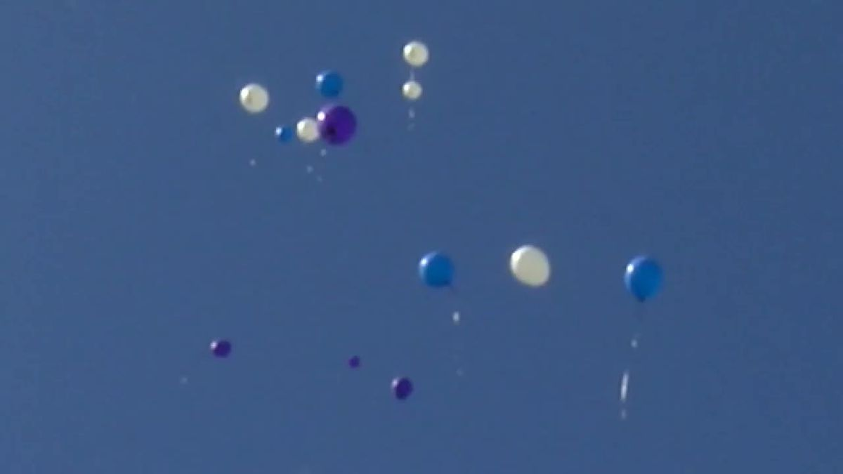 Balloon release marks grim anniversary of 4 found murdered in vacant Cleveland home