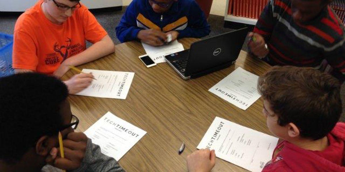 Akron middle school takes tech timeout