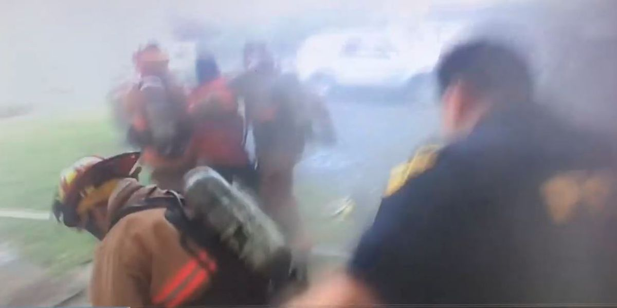 Cleveland Heights police officers rescue woman from burning home (video)