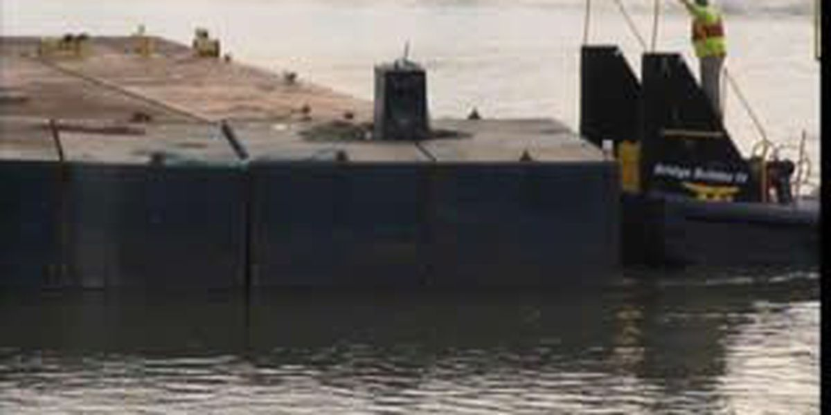 Sunken barge raised from Cuyahoga River