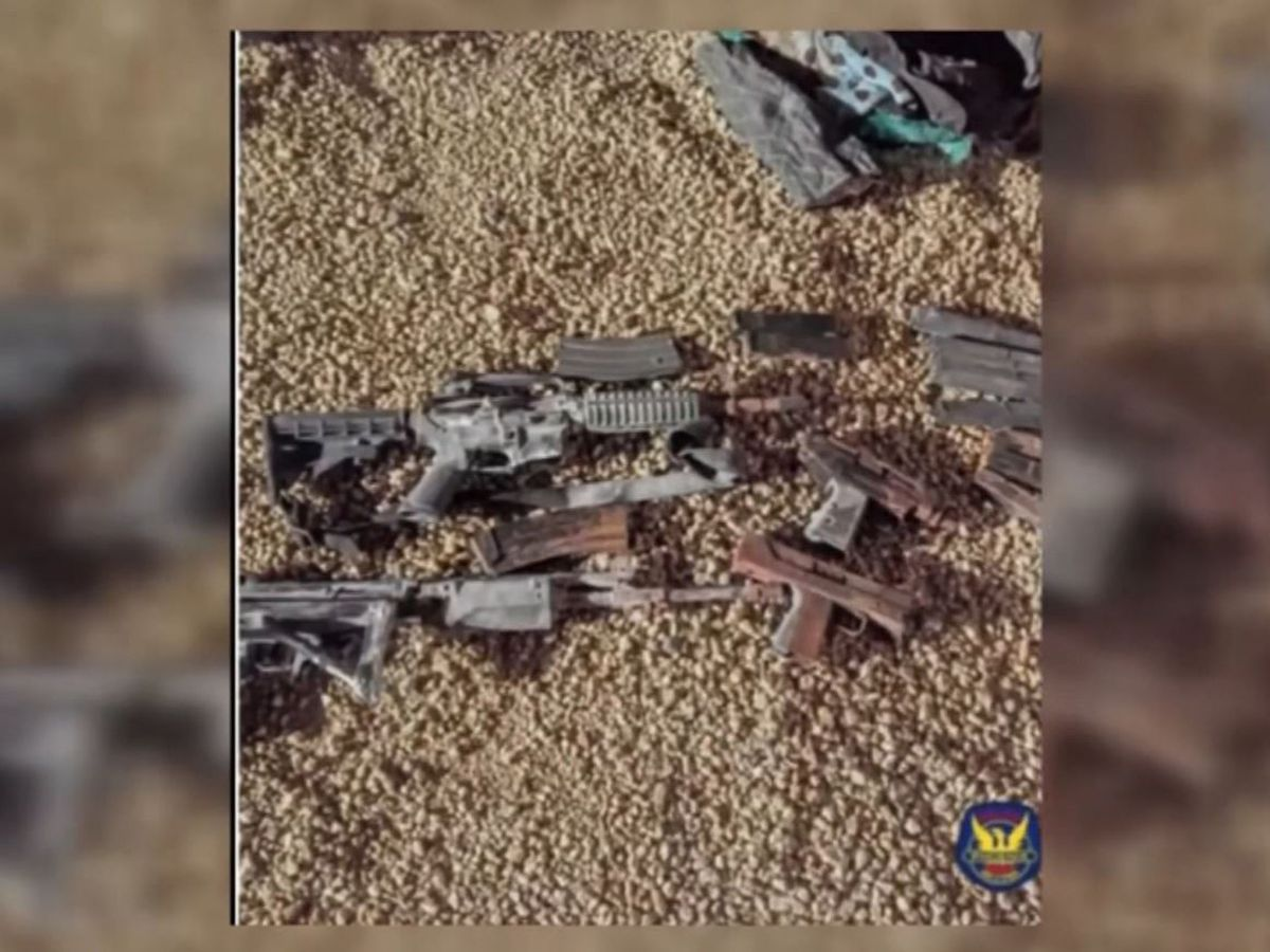 Homeowners dig up duffel bag full of guns in backyard