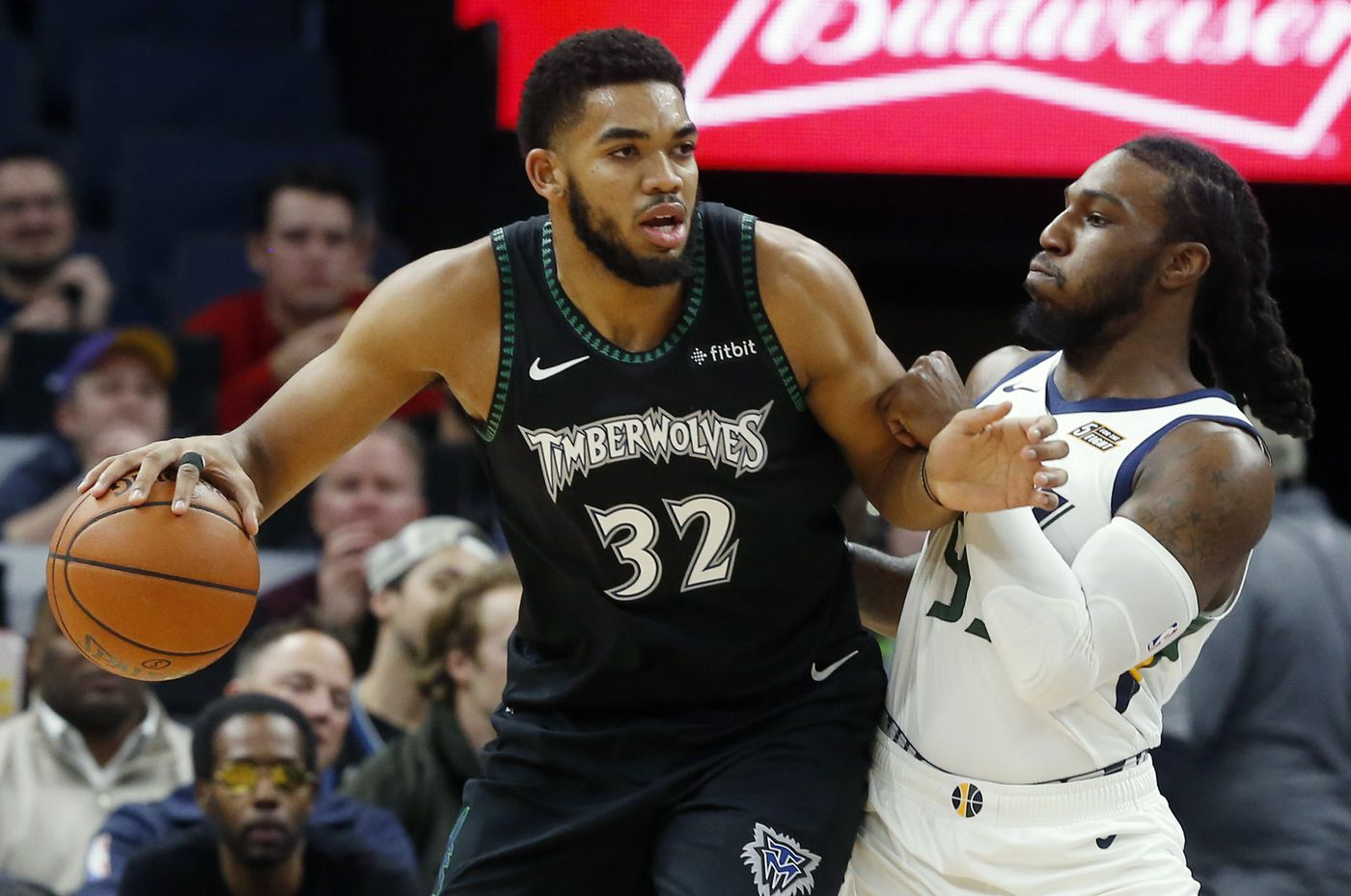 8304e110 Minnesota Timberwolves' Karl-Anthony Towns, left, works around Utah Jazz's  Jae Crowder