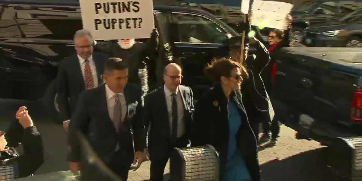 As Flynn arrives for sentencing, group sings 'God Bless America'