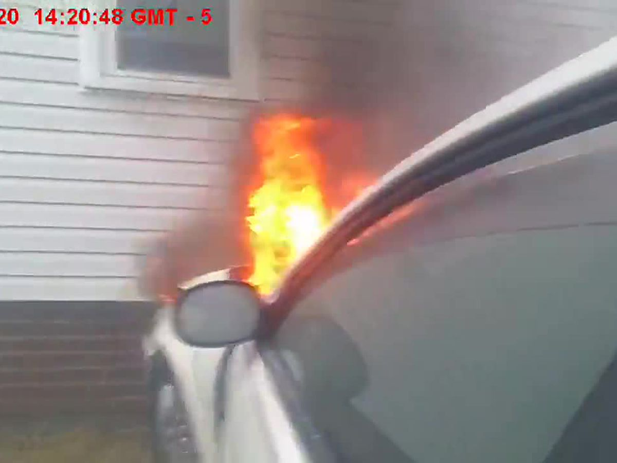 Daring Canton officer rescues man from car that burst into flames after crashing into building (video)