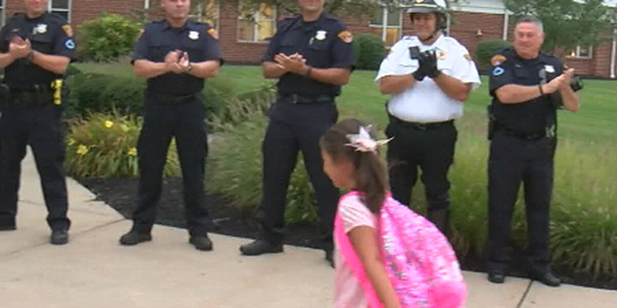 Cleveland police escort fallen officer's daughters to their first day of school