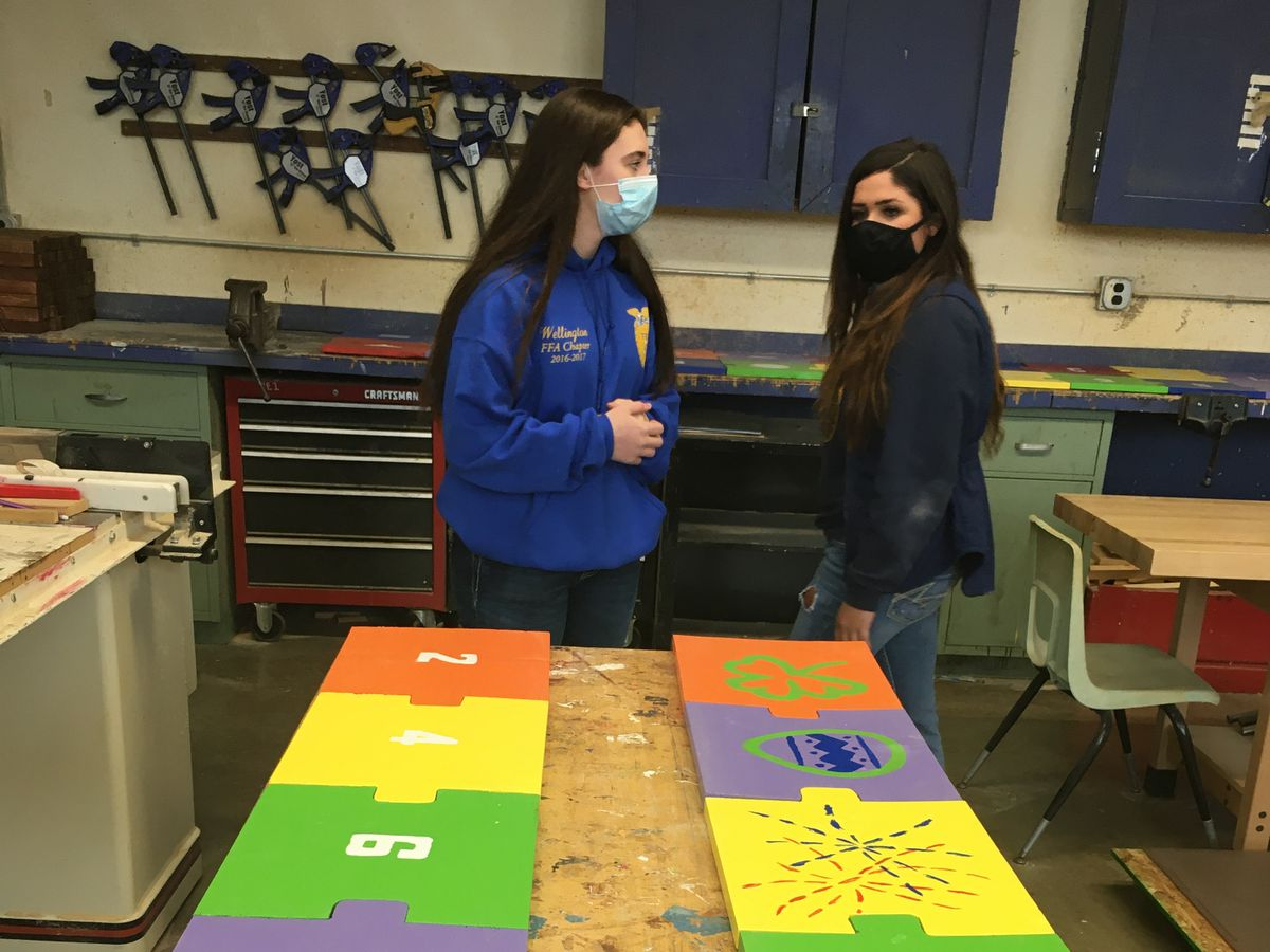 Wellington High School students build tools for social distancing in preparation for their return to the classroom