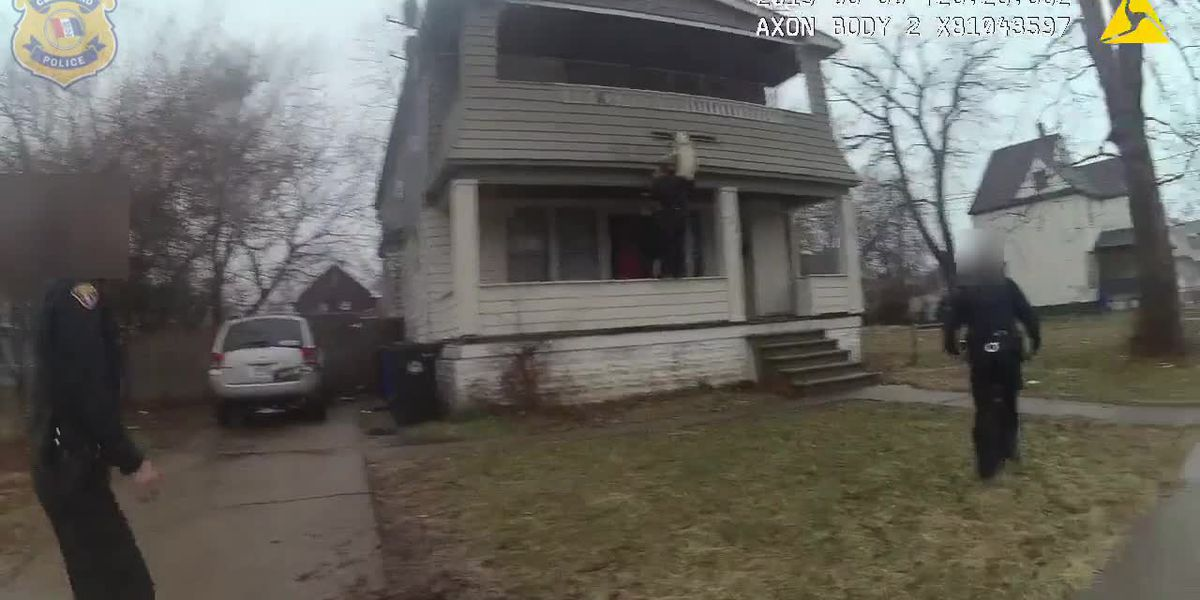 Cleveland officer rushes into action to save dog dangling from duplex