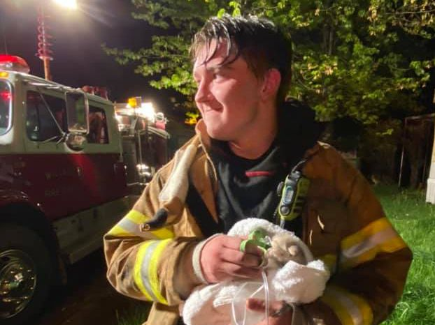 Willard firefighter administers oxygen to kitten pulled from mobile home fire