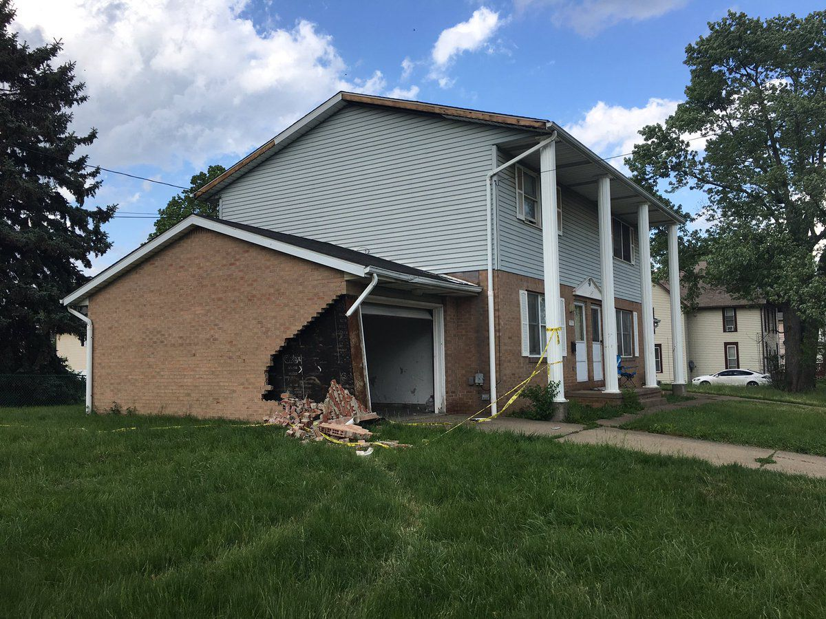 Canton cop cars collide, damage home