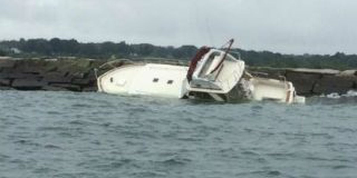 Pleasure craft is grounded for days on break wall in Conneaut Harbor