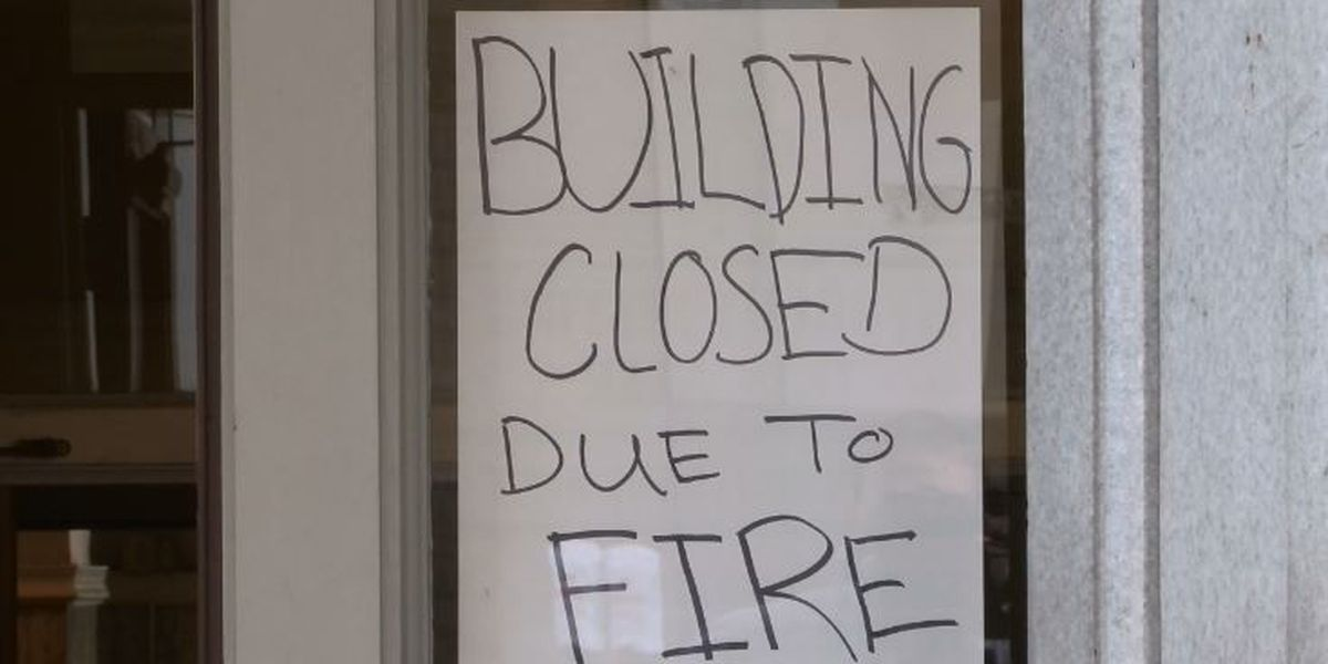 Fire officials access fire damage at downtown building
