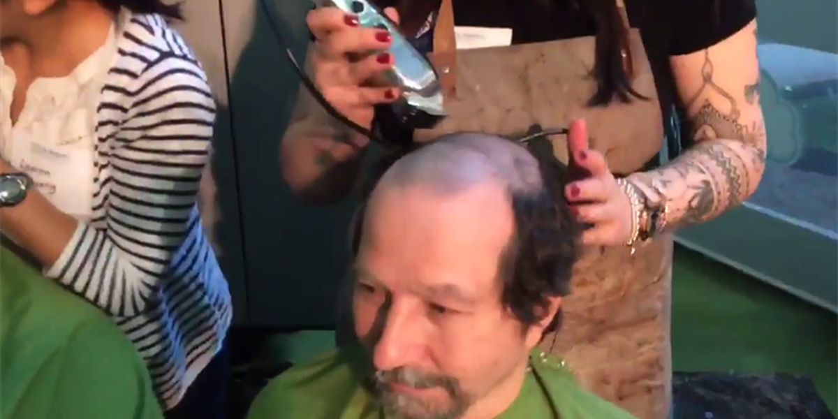 More than a 100 people in Cleveland shave their heads to raise money to fight childhood cancer