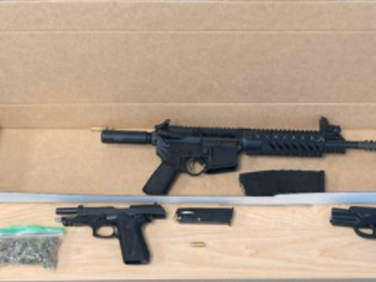 AR-15 and handgun with extended 33-round clip confiscated during illegal gun sweep on Akron's streets