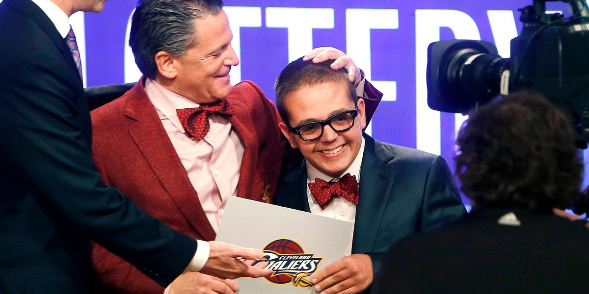 Nick Gilbert, son of Cavs owner, receives ovation at game days after hospital release