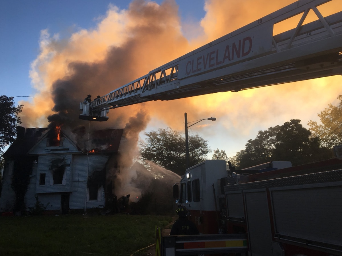 Crews remain on scene after house destroyed by fire on Cleveland's east side