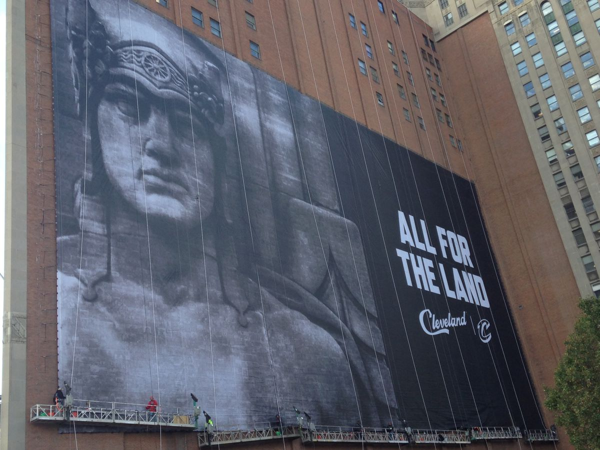 'All for the Land': New banner goes up on Sherwin-Williams building