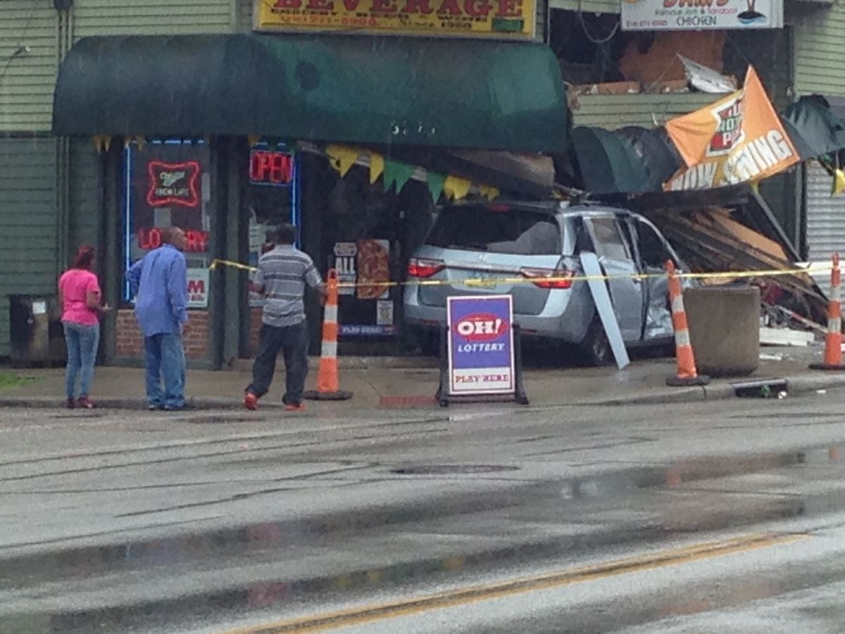 Woman crashes minivan into store on Cleveland's East Side