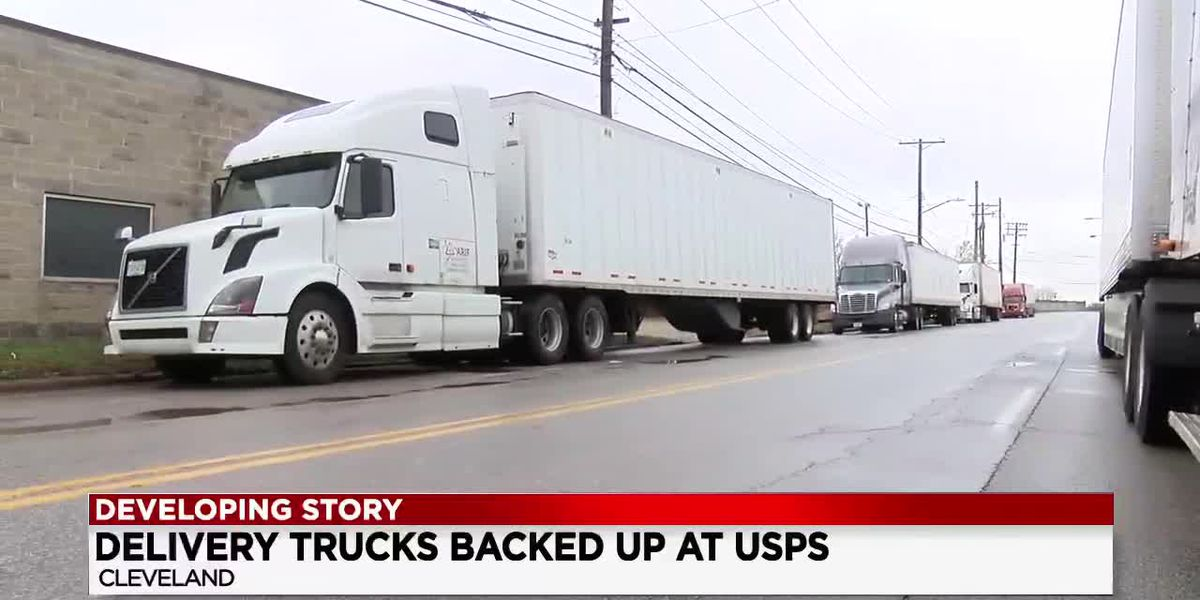 Tractor-trailers crowd street outside Broadway Avenue USPS Postal Office; drivers frustrated with delay