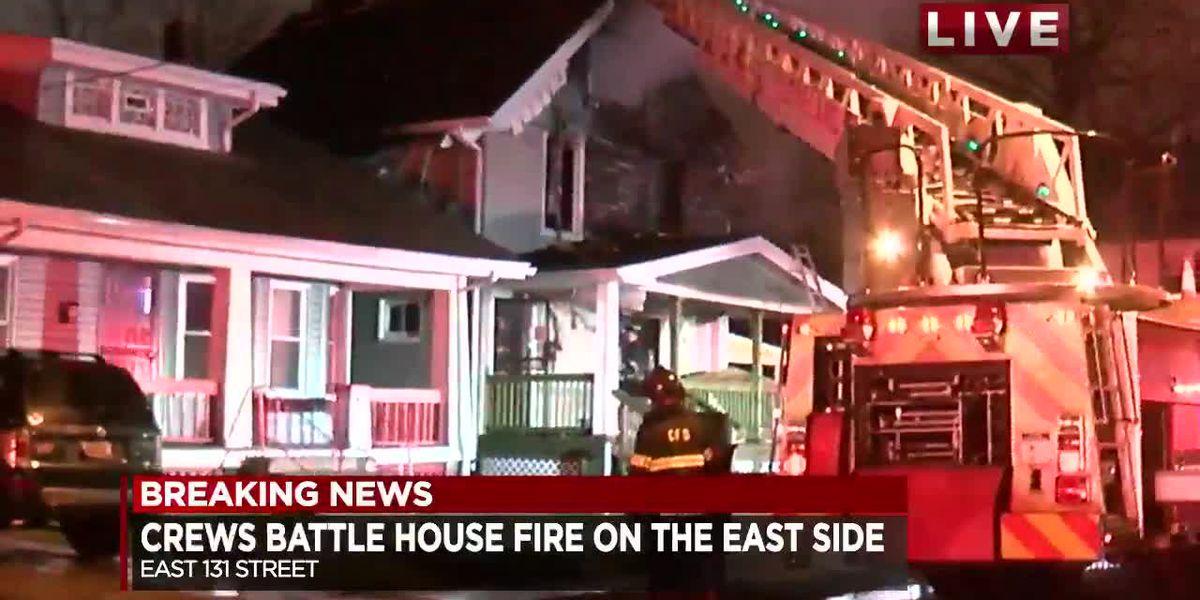 Cleveland firefighters battle East Side house fire