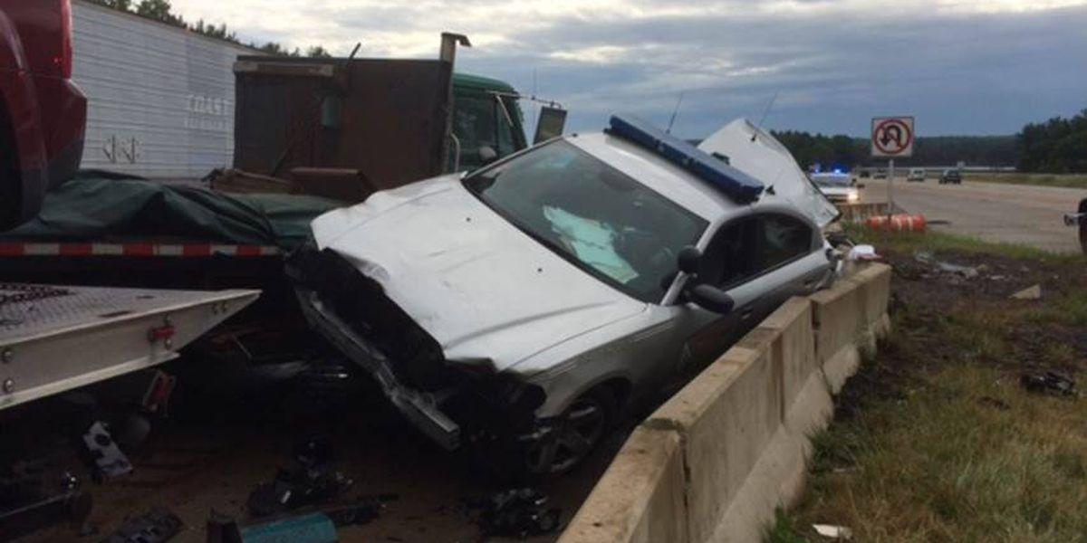 Truck knocks cruiser into trooper investigating crash