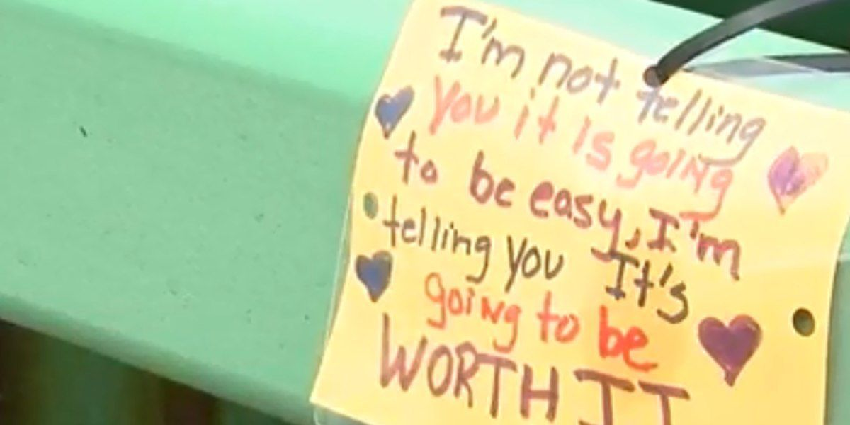Man caught on camera taking messages of hope off bridge known for suicides