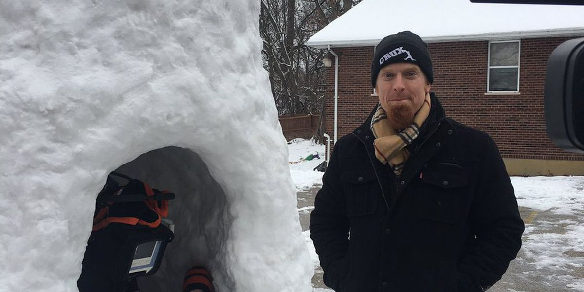 Dad praised for building handicap-accessible snow fort