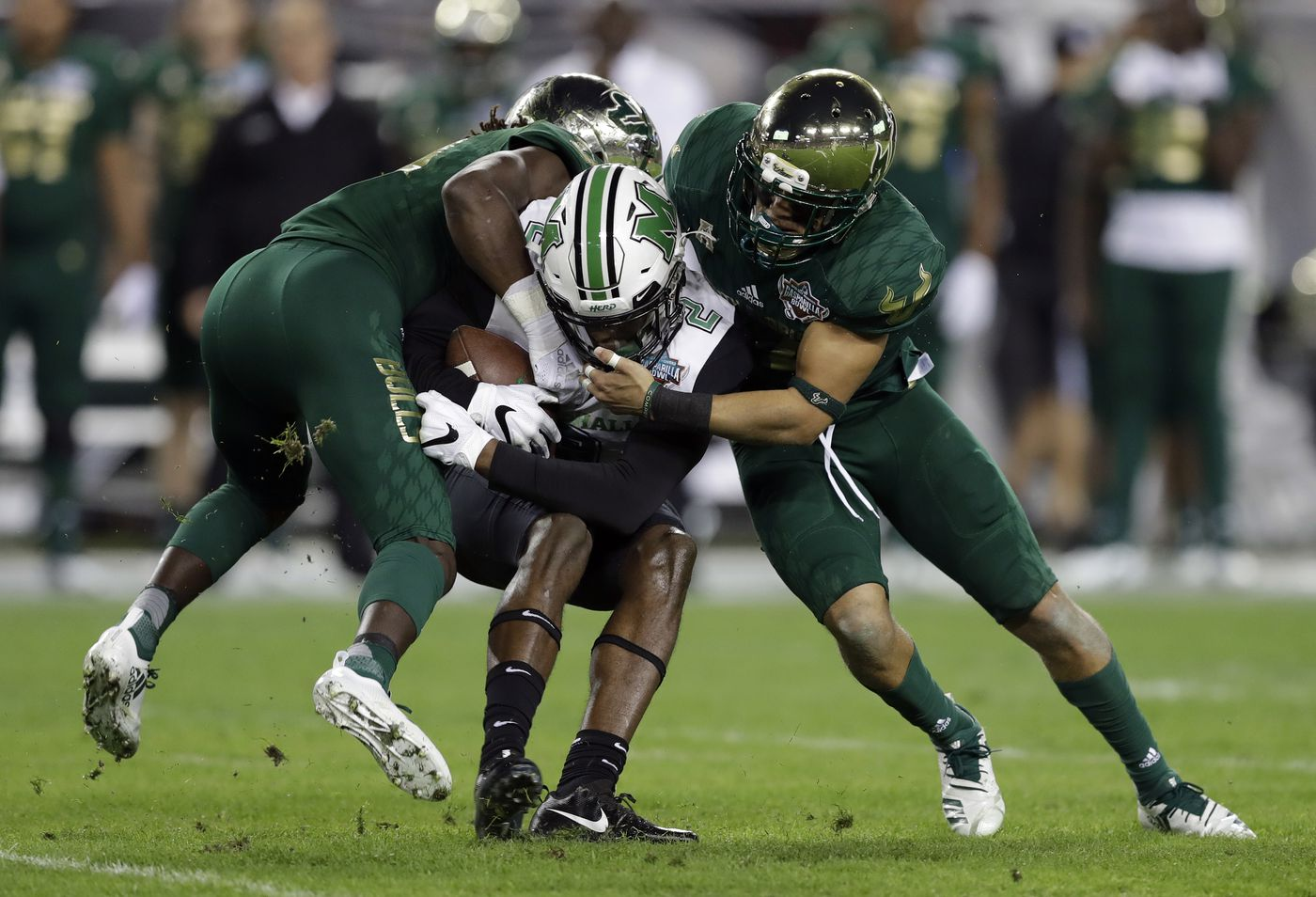 29c6d8866 Marshall wide receiver Artie Henry III (2) is sandwiched by South Florida  cornerback Ronnie