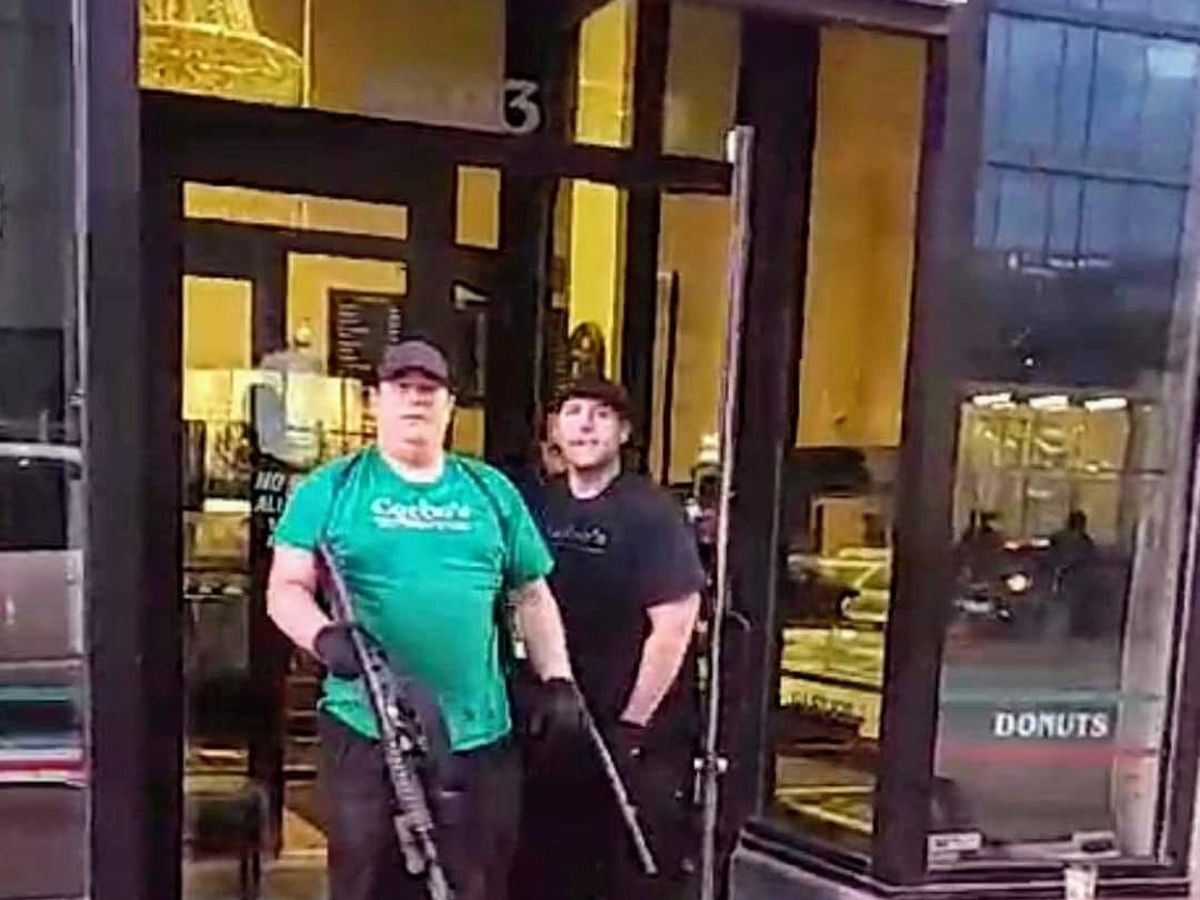 'Standing strong': Corbo's Bakery owners, armed with shotguns, protect their business from protesters