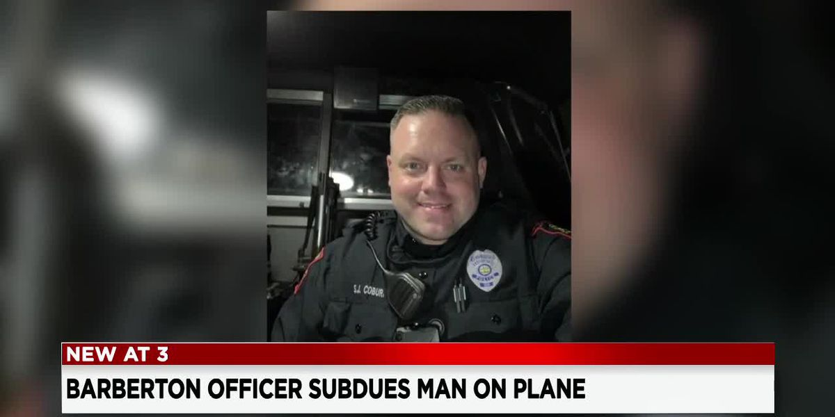 Barberton police officer being called a hero after subduing a man who tried to open plane door