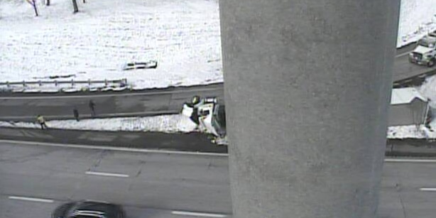 Semi-truck topples over on I-90 W at W. 117th Street