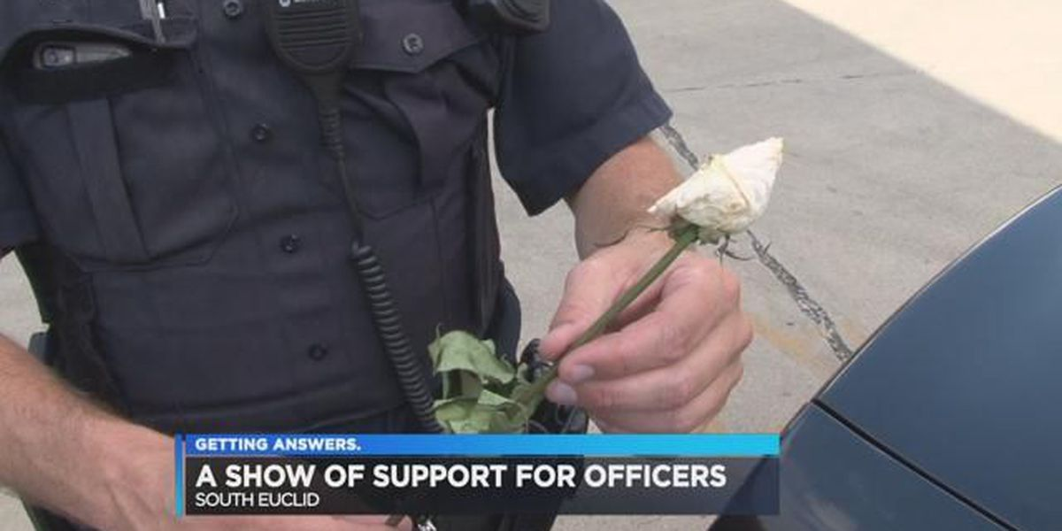 Local pastor leaves roses to show support for cops