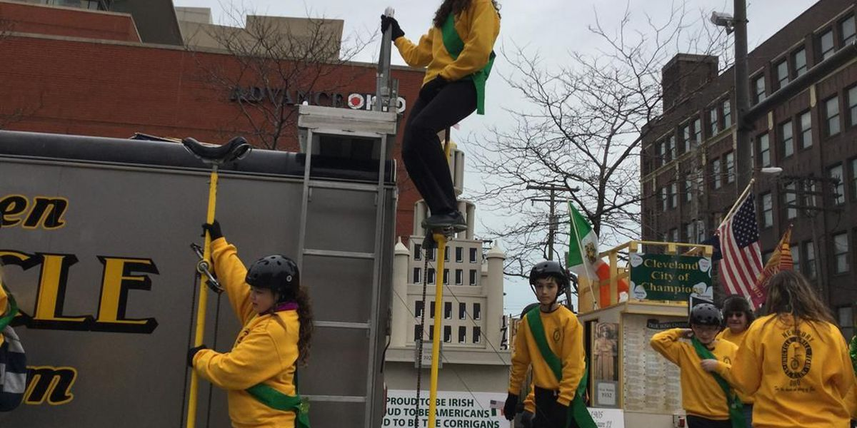 Kid riding eight-foot tall unicycle at Cleveland St. Patrick's Day parade