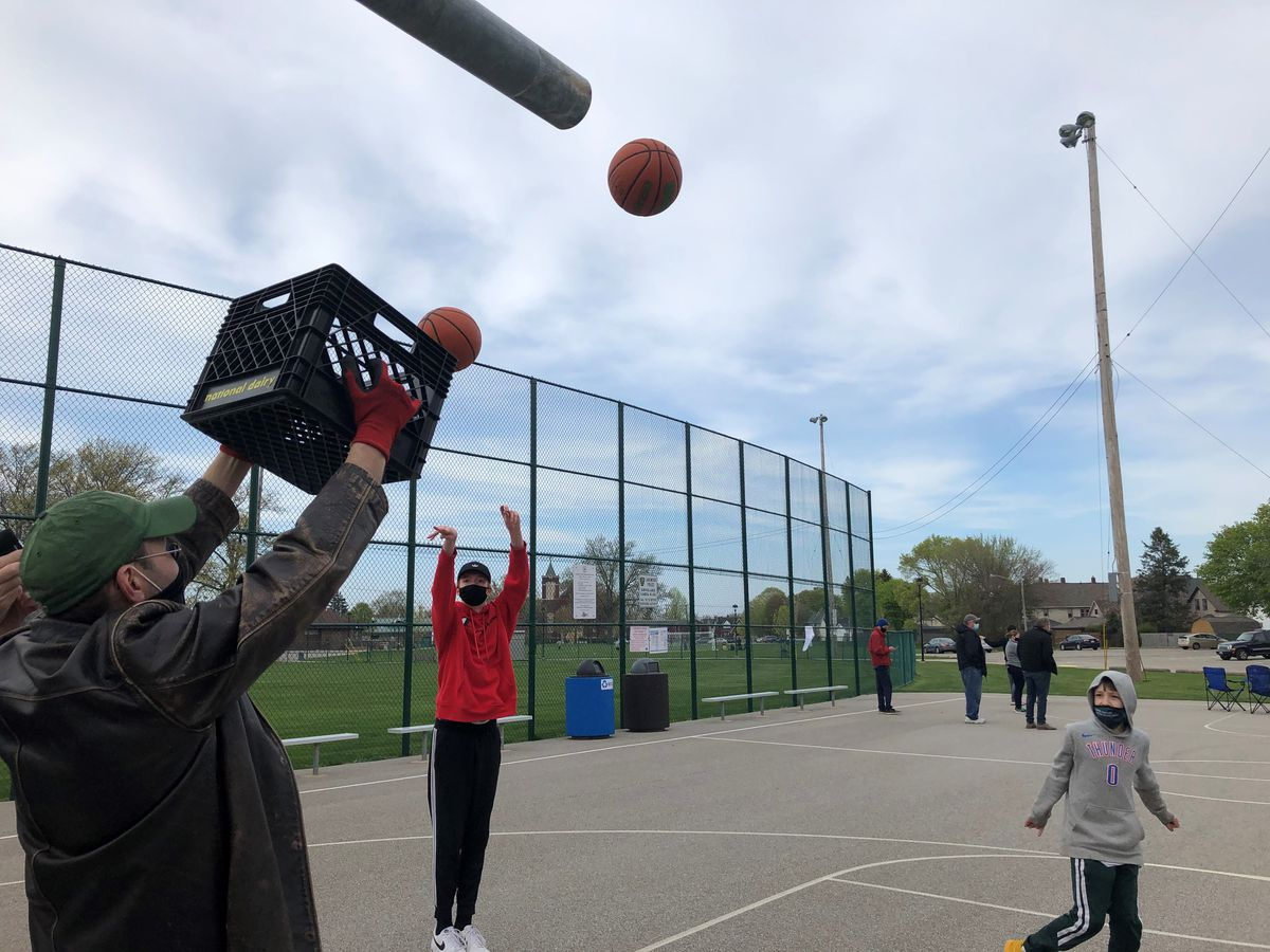 A peaceful protest was held in Madison Park Tuesday evening after hoops from the basketball court were taken off