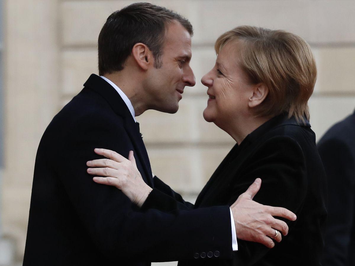 Macron, Merkel seek common approaches to Trump, euro