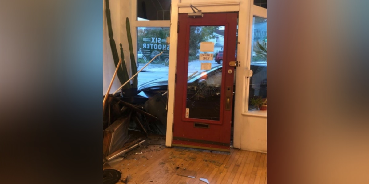 Workers forced to run for their lives inside Six Shooter Coffee shop as car comes crashing through the front window