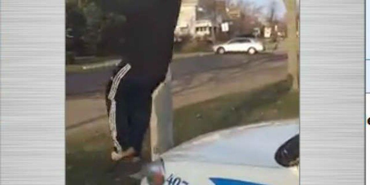 Akron police cruiser vandalized, suspects in custody