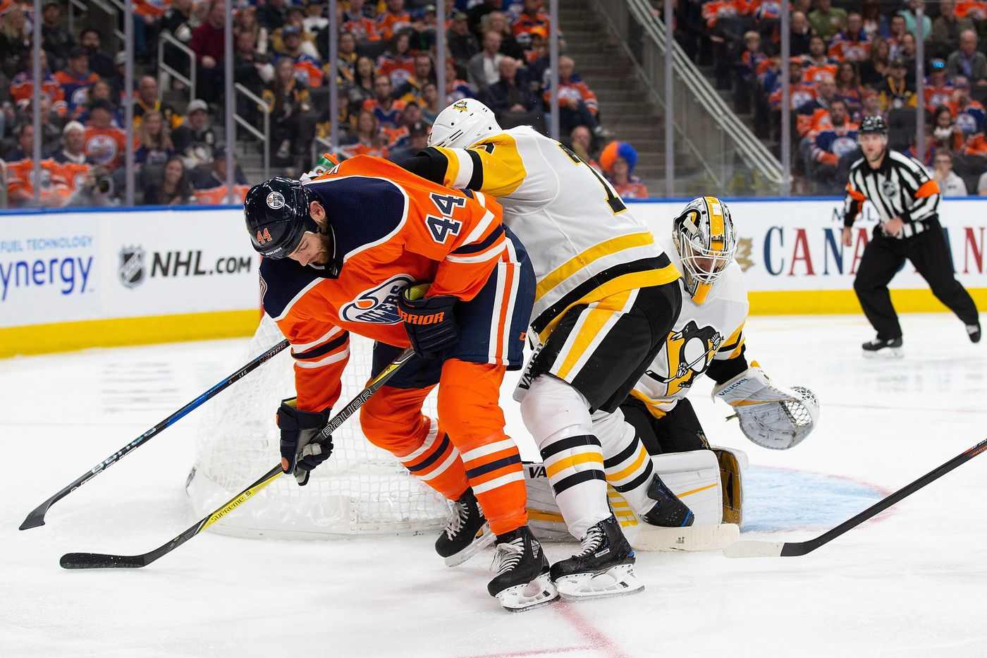 Edmonton Oilers  Zack Kassian (44) is shoved away from the net by Pittsburgh c1341dafd