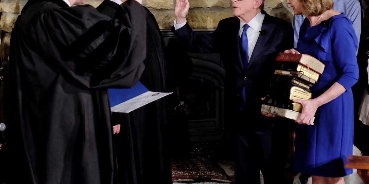 The Latest: New governor sworn in at home