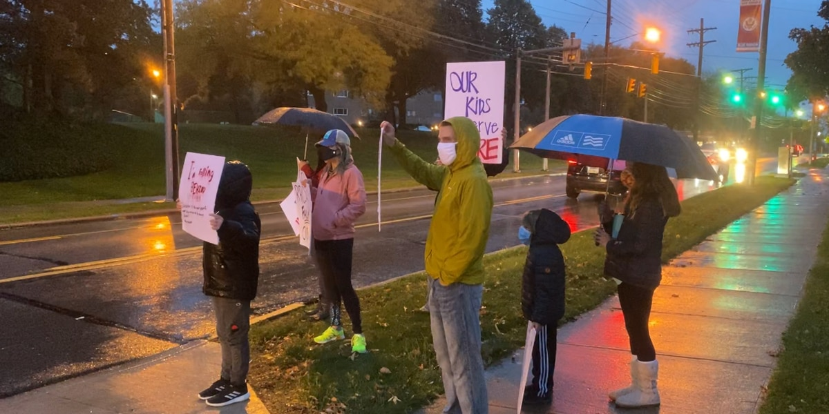Nearly a dozen Rocky River parents, kids brave rain for protest over hybrid learning model