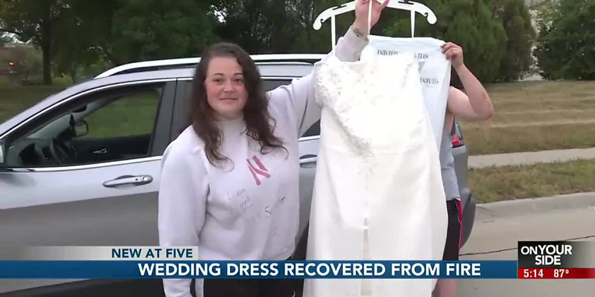 Firefighters return to apartment to save woman's wedding dress from massive fire