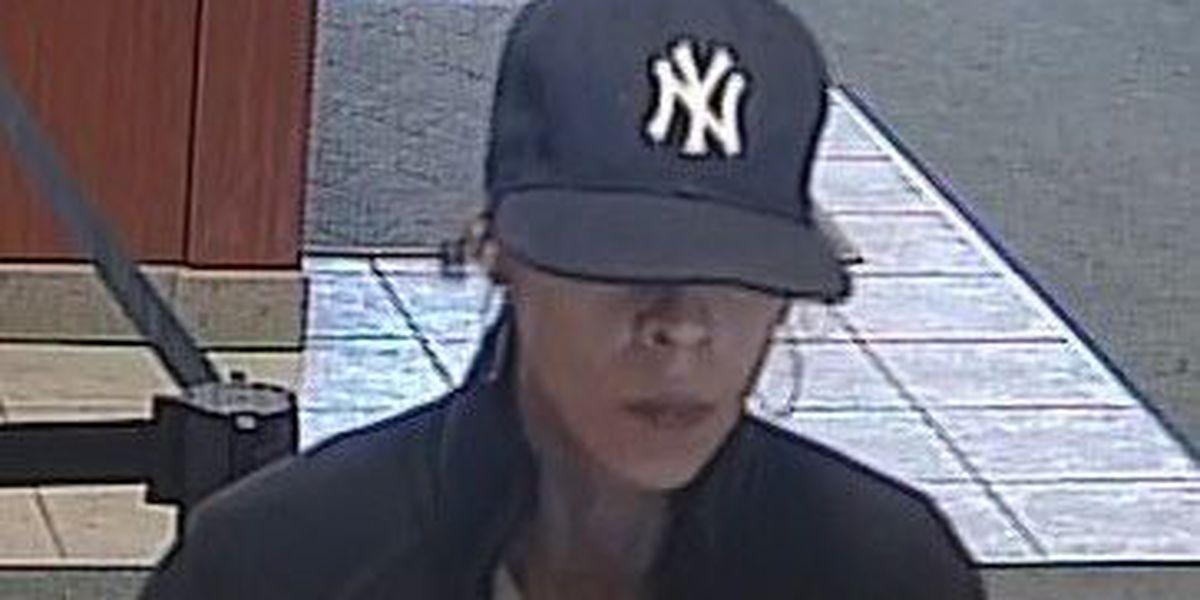Woman robs bank wearing Yankee cap