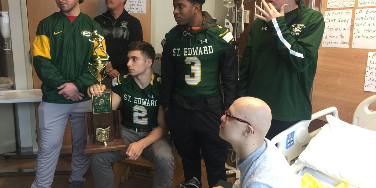 St. Edward football team visits UH to celebrate championship with cancer patient