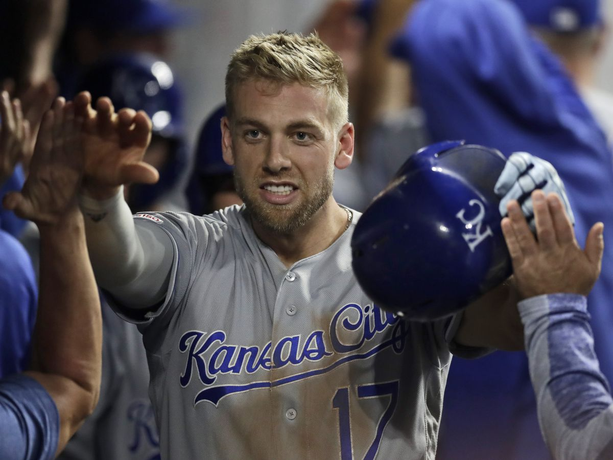 Dozier's slam leads Royals to 8-6 comeback win over Indians