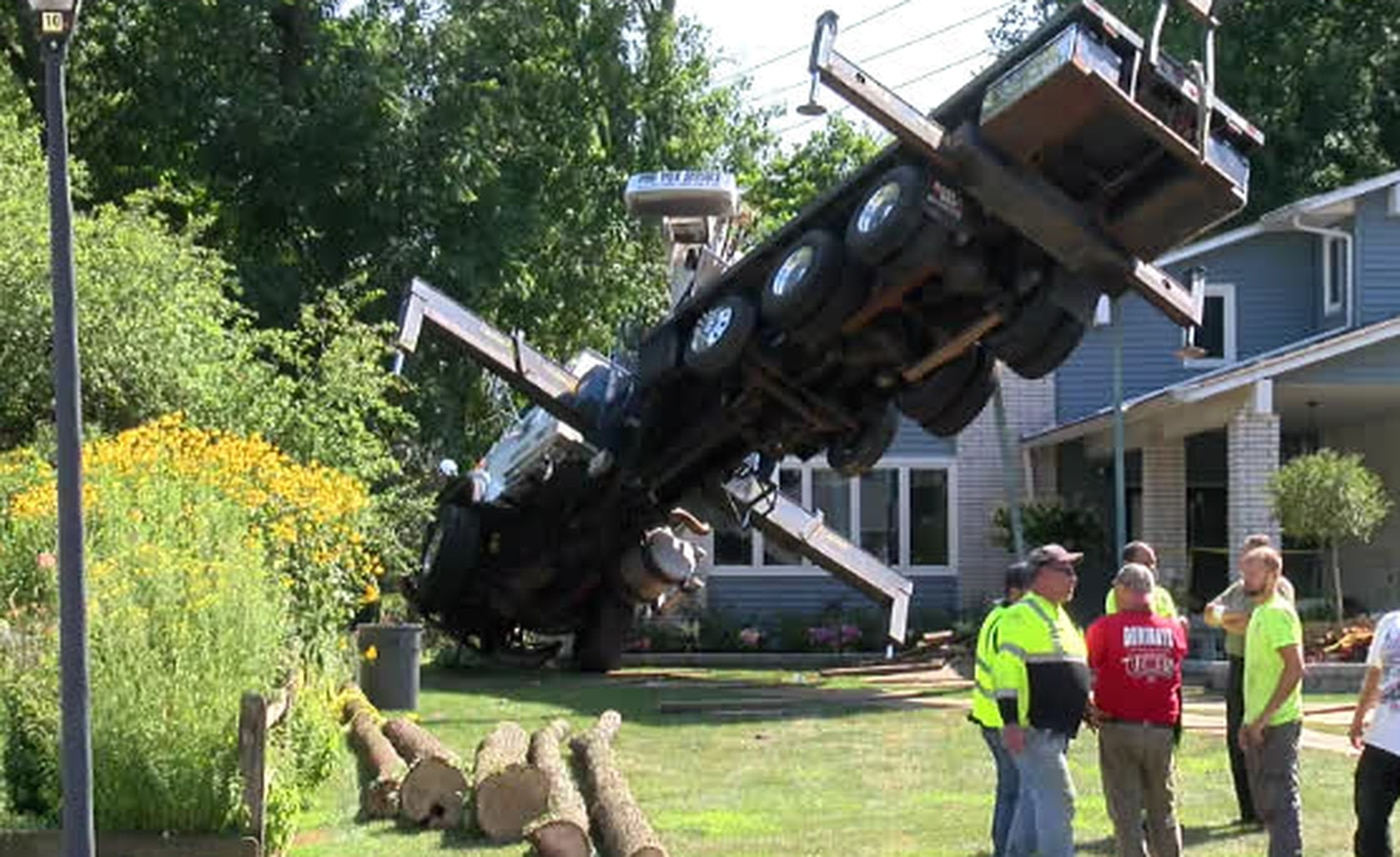 Tree trimming crane topples onto house in Willoughby