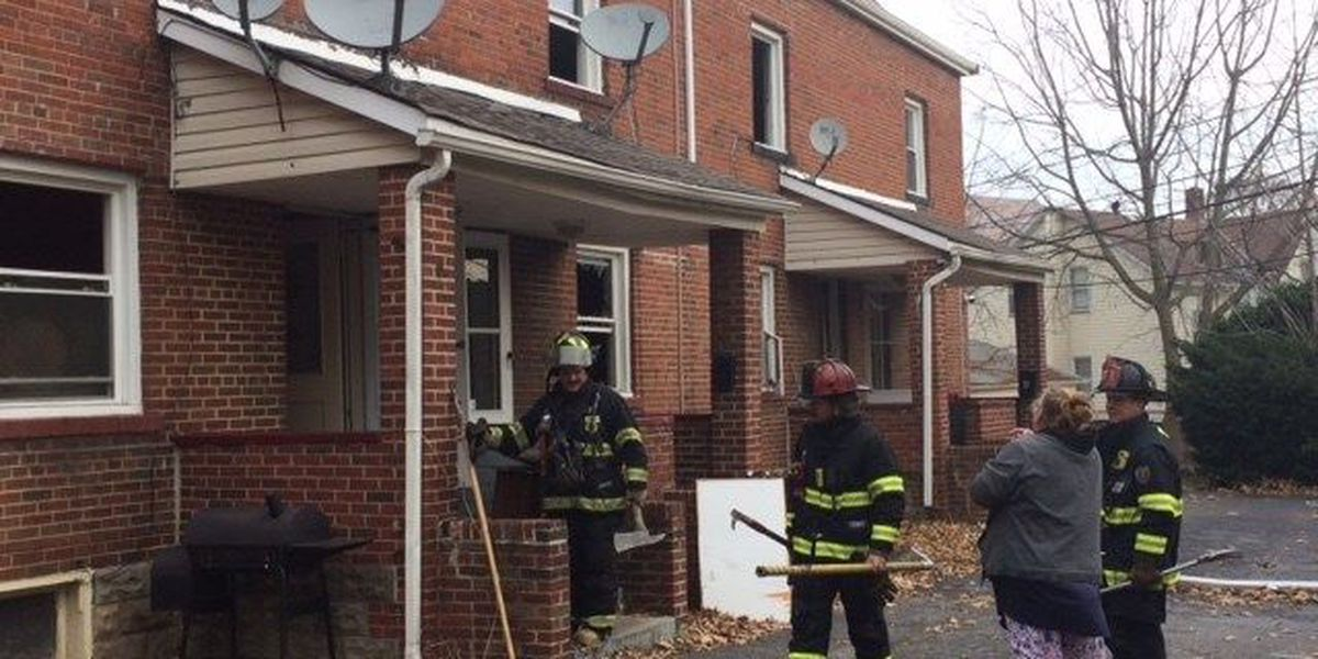Arson suspected in west side row house fire