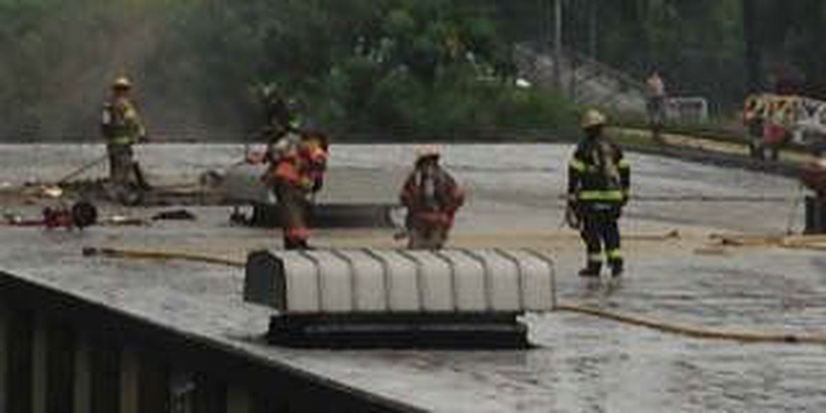Multiple firefighters battle blaze at local health department