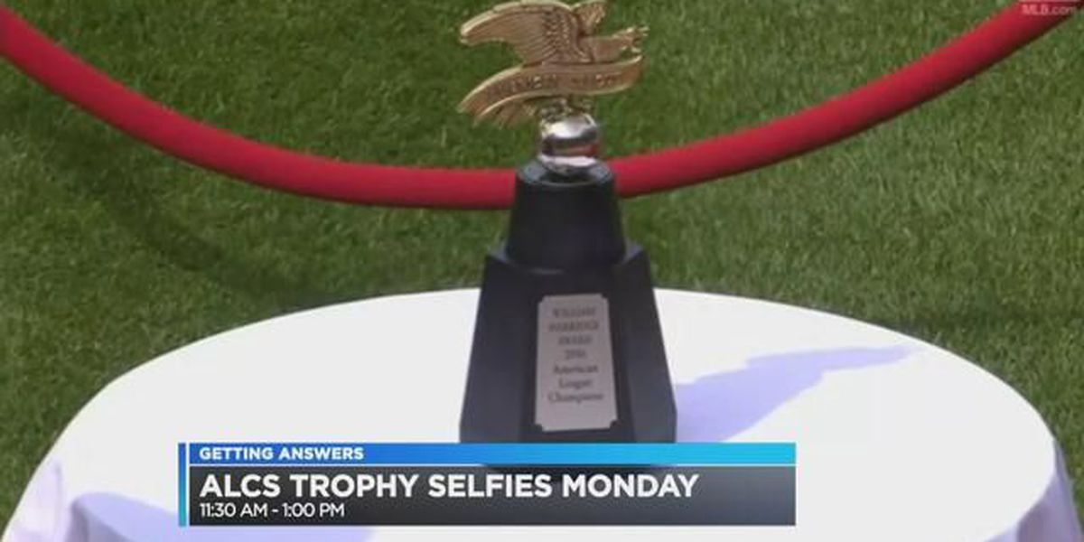 Take a selfie with the AL Championship trophy