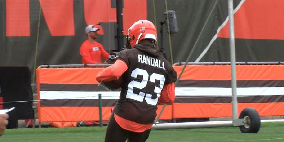 Damarious Randall intercepts Andy Dalton pass and hands ball to Hue Jackson