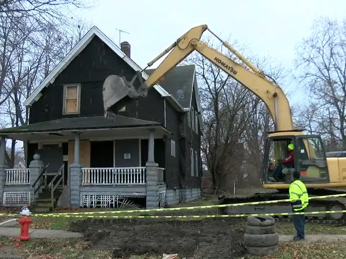 What determines when an abandoned house comes down in Cleveland?