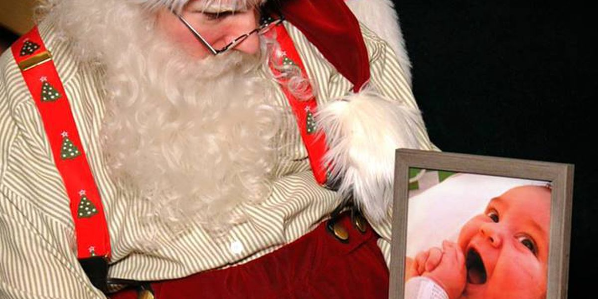 Grieving father asks mall Santa to take a photo with picture of his son